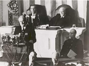 "President Franklin Roosevelt delivers his speech asking Congress to declare war on Dec. 8, 1941 -- the date ""which will live in infamy."""