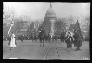 Jane Burleson, grand marshal of the 1913  Washington Suffrage Parade, halts at the beginning of the parade to see that the participants are following her.